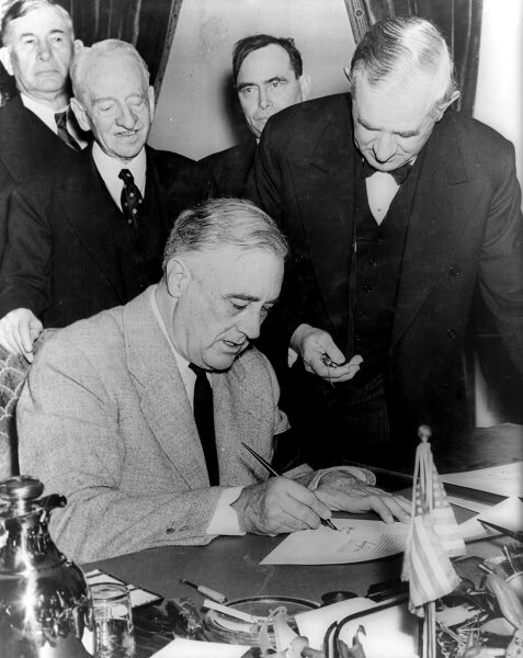 Franklin Delano Roosevelt signing the declaration of war against Germany on December 11, 1941. Three days earlier he had done the same against Japan. (Image: Wikipedia)