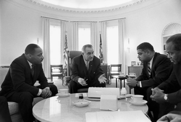 President Lyndon B. Johnson meets with civil rights leaders Rev. Martin Luther King Jr. (left), Whitney Young, and James Farmer in the Oval Office in 1964. (Image: Wikipedia)