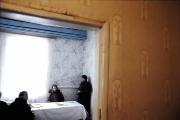 MOLDOVA. Transdniester. 2004. People attending a church-run soup kitchen. Most Transdniestrians are poor, and a large portion of the population are pensioneers longing for the better times of the USSR. (Screenshot/YouTube)