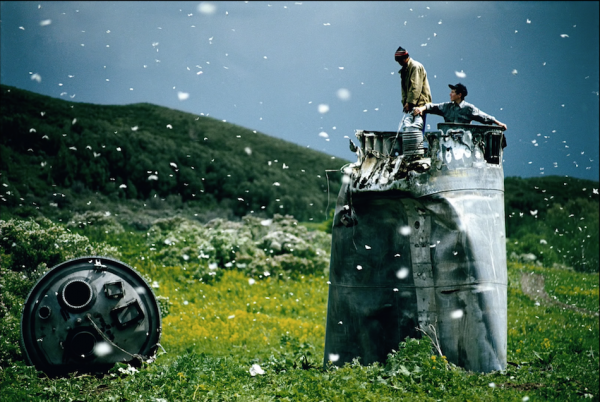 RUSSIA. Altai Territory. 2000. Villagers collecting scrap from a crashed spacecraft, surrounded by thousands of white butterflies. Environmentalists fear for the region's future due to the toxic rocket fuel. (Screenshot/YouTube)