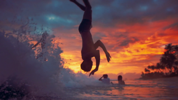 Kids swimming in the ocean, launching off each other's shoulders. (Screenshot/Vimeo)