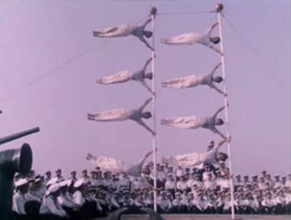 The 'flag,' showing the remarkable core strength of pole acrobats. (Screenshot/YouTube)