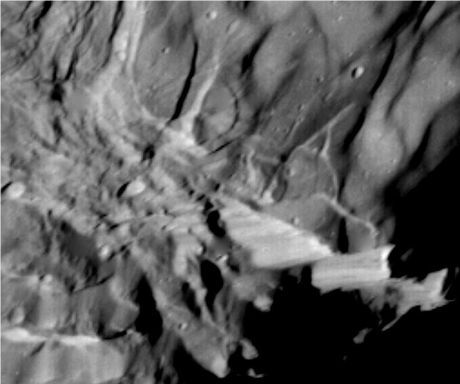 The above image of Verona Rupes was captured by the passing Voyager 2 robotic spacecraft in 1986. How the giant cliff was created remains unknown, but is possibly related to a large impact or tectonic surface motion. Image: Voyager 2, NASA