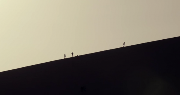 Or climb the dunes and marvel at the view. (Screenshot/YouTube.)