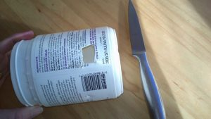 Cut a small hole in your container with sharp knife (Image:Chani Blue)