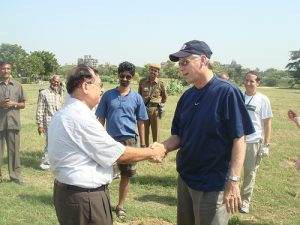 Continue to talk as you shake hands, it feels more natural and relaxed for both parties (Image:US Embassy New Dehli/flickr)