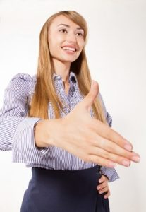 Women should shake hands in professional settings (Image:victor69/123rf)