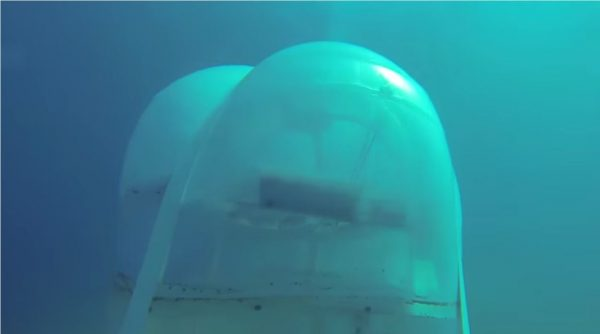Two years — and many rough storms — later, the company had their fleet of biospheres anchored to the sea floor. (Screenshot/YouTube)