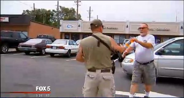 He is able to stand guard because you don't need a permit to openly carry guns in Virginia. (Screenshot/Fox5)