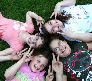 What does well-being look like? Confident children who know how to have fun (Image:Kels Photo Images/flickr)