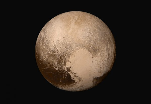 Four images from New Horizons' Long Range Reconnaissance Imager (LORRI) were combined with color data from the Ralph instrument to create this sharper global view of Pluto. (Image: NASA/JHUAPL/SwRI)