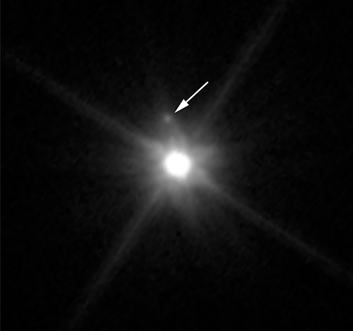 This Hubble image reveals the first moon ever discovered around the dwarf planet Makemake. The tiny satellite, located just above Makemake in this image, is barely visible because it is almost lost in the glare of the very bright dwarf planet. Hubble's sharp-eyed WFC3 made the observation in April 2015. (Image: NASA, ESA, and A. Parker and M. Buie (SwRI)
