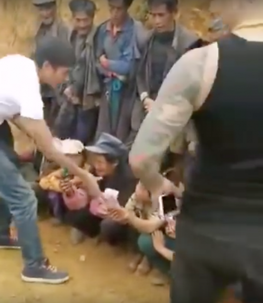 The deceit was uncovered when another video emerged showing Brother Jei and the other man men taking the money back from the villagers. (Image: YouTube screenshot)