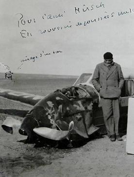 Antoine de Saint-Exupéry standing next to his plane after it crashed in the Sahara Desert 1935. (Image via Wickimedia Commons By Saint-Exupéry/André Prévot [Public domain or Public domain], via Wikimedia Commons)