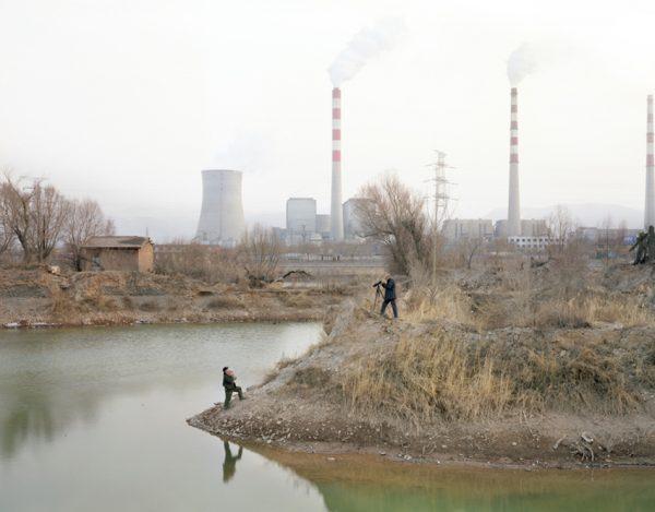 Two men taking photographs by the Yellow river in Gansu. (Image: Zhang Kechun)