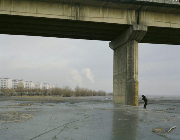 Man Doing Morning Exercise Under the Bridge with Mask, Ningxia. (Image: Zhang Kechun)