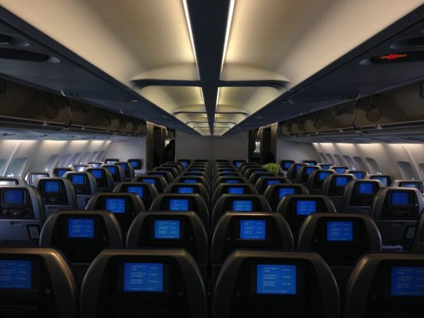 While on-demand touch screens were usually reserved just for first class passengers, their abundance on most major commercial flights has made it more of a standard feature that flyers expect in all classes. (Image: pixabay / CC0 1.0)