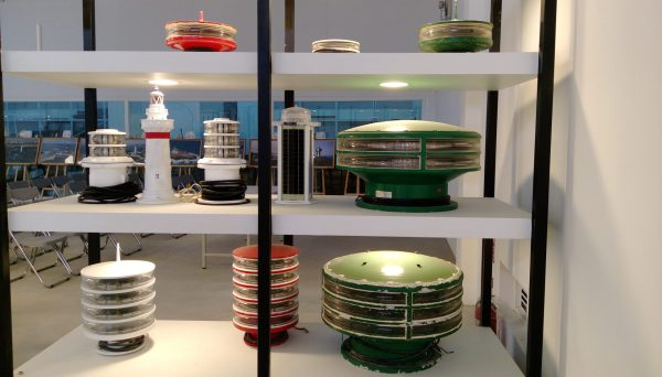 Lighthouse models and photographs, as well as various light house lamps, lenses and other optical systems are displayed at the Lighthouse Museum. (Image: Juliet Fu/ Vision Times)