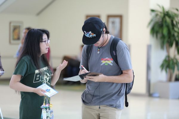 Iris collecting signatures at the University of South Florida for a petition urging the release of her mother. (Image: Hill Liu)