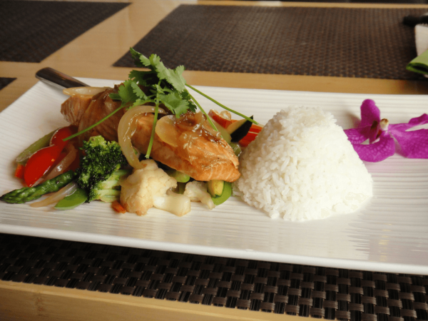 Chef Wolfgang Puck set the tone with his borrowings of Asian ingredients with French cooking techniques. (Image: Calgary Reviews via flickr CC BY 2.0 )