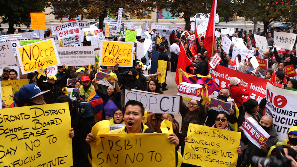 Confrontation between the pro- and anti- Confucius Institute demonstrators escalates at the Toronto District School Board. (Image via Films Website)
