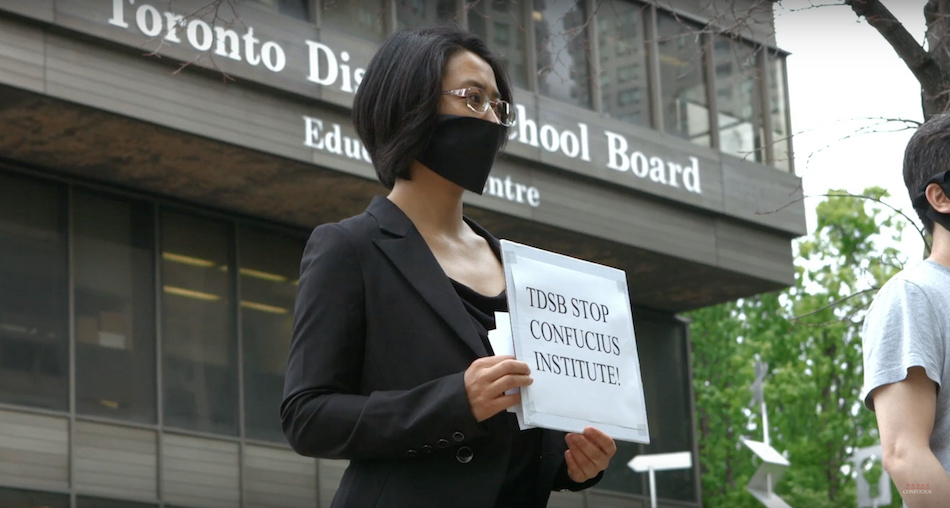 Former CI teacher Sonia Zhao protests the Confucius Institute at the Toronto District School Board. (Image via Films website)