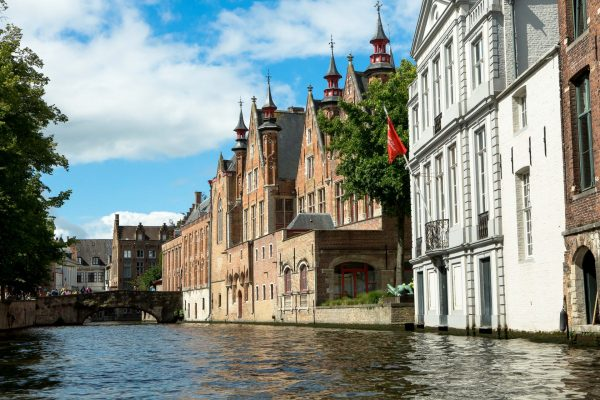 View of Bruges' medieval buildings from a boat on one of the cities canals. (Photo: Hermann Rohr for the Vision Times)