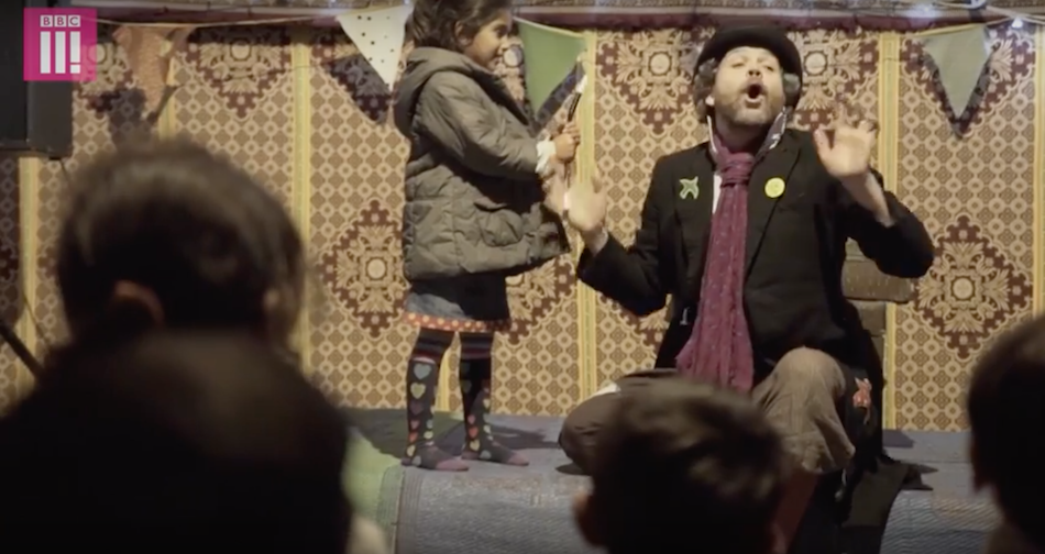 The British group use the power of play to help the kids let go of some anxiety. (Image via BBC Three YouTube/Screenshot)