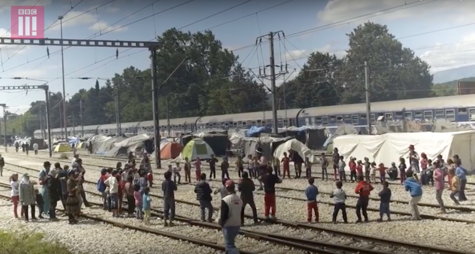 The group has been bringing a lot of isolated children out of their tents and forming a sense of community and joy. (Image via BBC Three YouTube/Screenshot)