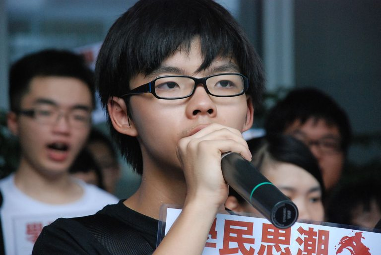 In an indifferent and unpredictable environment, a person's thinking and reactions depend on the quality of their character. Joshua Wong speaking at gathering in Hong Kong, 2012. (Image: wikimedia / CC0 1.0)