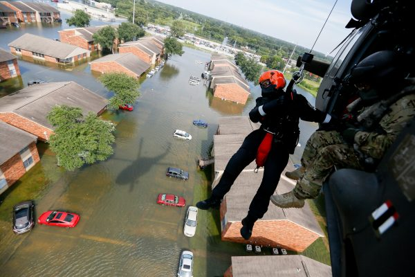 Members of the South Carolina's Helicopter Aquatic Rescue Team (SC-HART) perform rescue operations in Port Arthur, Texas, August 31, 2017. The SC-HART team consists of a UH-60 Black Hawk helicopter from the South Carolina Army National Guard with four Soldiers who are partnered with three rescue swimmers from the State Task Force and provide hoist rescue capabilities. Multiple states and agencies nationwide were called to assist citizens impacted by the epic amount of rainfall in Texas and Louisiana from Hurricane Harvey. (U.S. Air National Guard photo by Staff Sgt. Daniel J. Martinez) via under