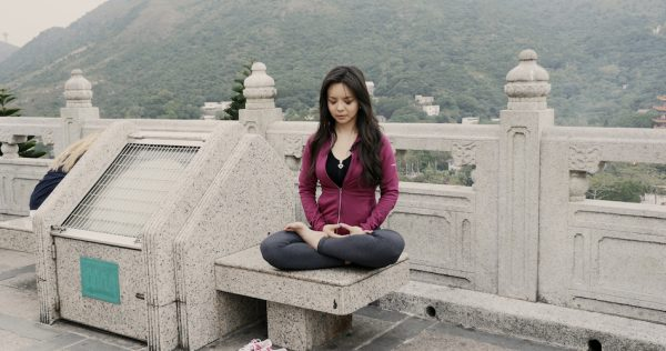 Lin doing the Falun Dafa Meditation exercise. (Image via media kit Badass Beauty Queen Film)