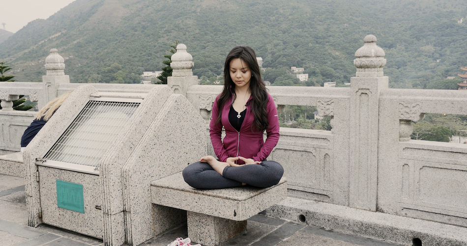 Lin doing the Falun Dafa Meditation exercise. (Image via media kit Badass Beauty Queen Film)