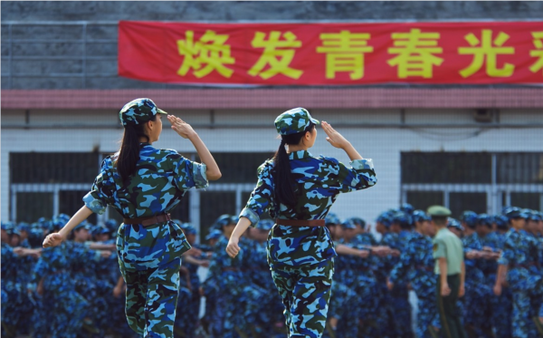 Chinese females saluting at military competition. ( Image Credit: Baryl_SNW PxhereCC0