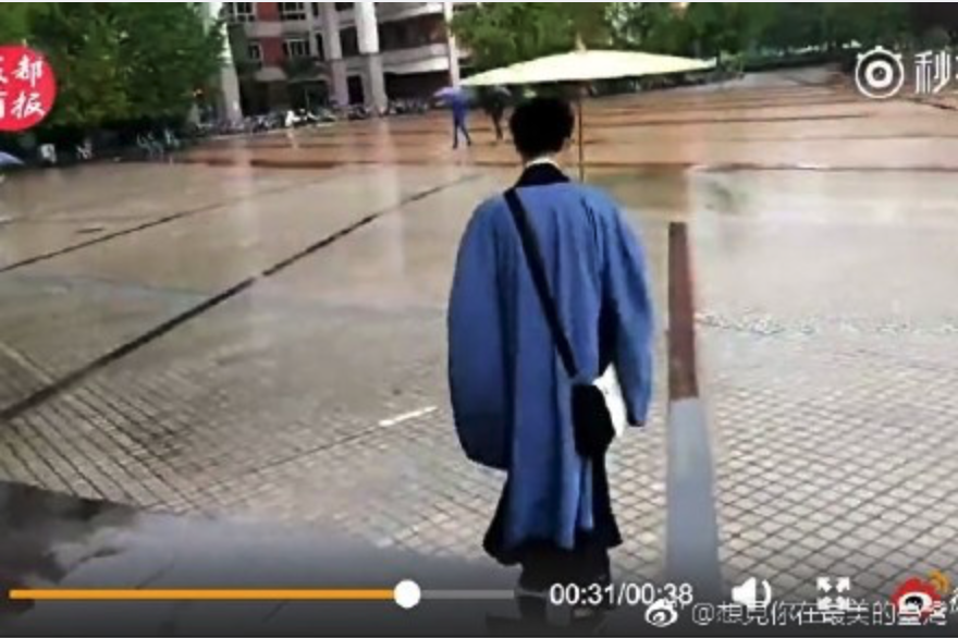 "The student hopes he can continue to wear his costume, even when he goes out and that his ""future girlfriend can accept it."" (Image Credit.: Screenshot/ Weibo/Chinese Media想見你在最美的臺灣 , s.weibo"