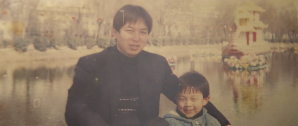 A photo of Eric and his father when they were together in China. (Image via Alexander Vimeo/Screenshot)