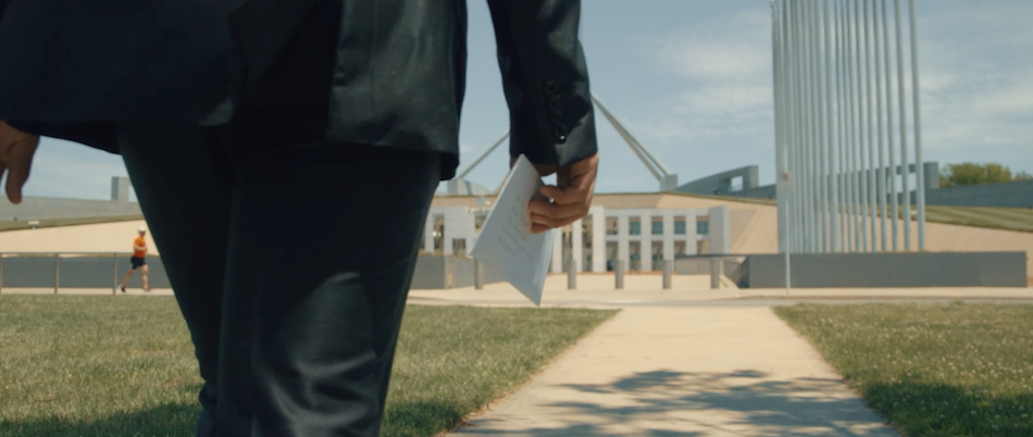 Eric taking his letter addressed to Malcolm Turnbull to Parliament House in Canberra. (Image via Alexander Vimeo/Screenshot)