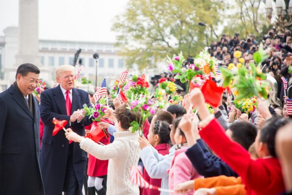 Trump was feted with children waving U.S. and Chinese flags. (Image: flickr / CC0 1.0)