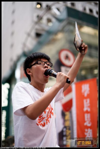 Joshua speaking at a protest in Victoria Park in 2013. (Image: Pacific Chillino via flickr CC BY-SA 2.0)