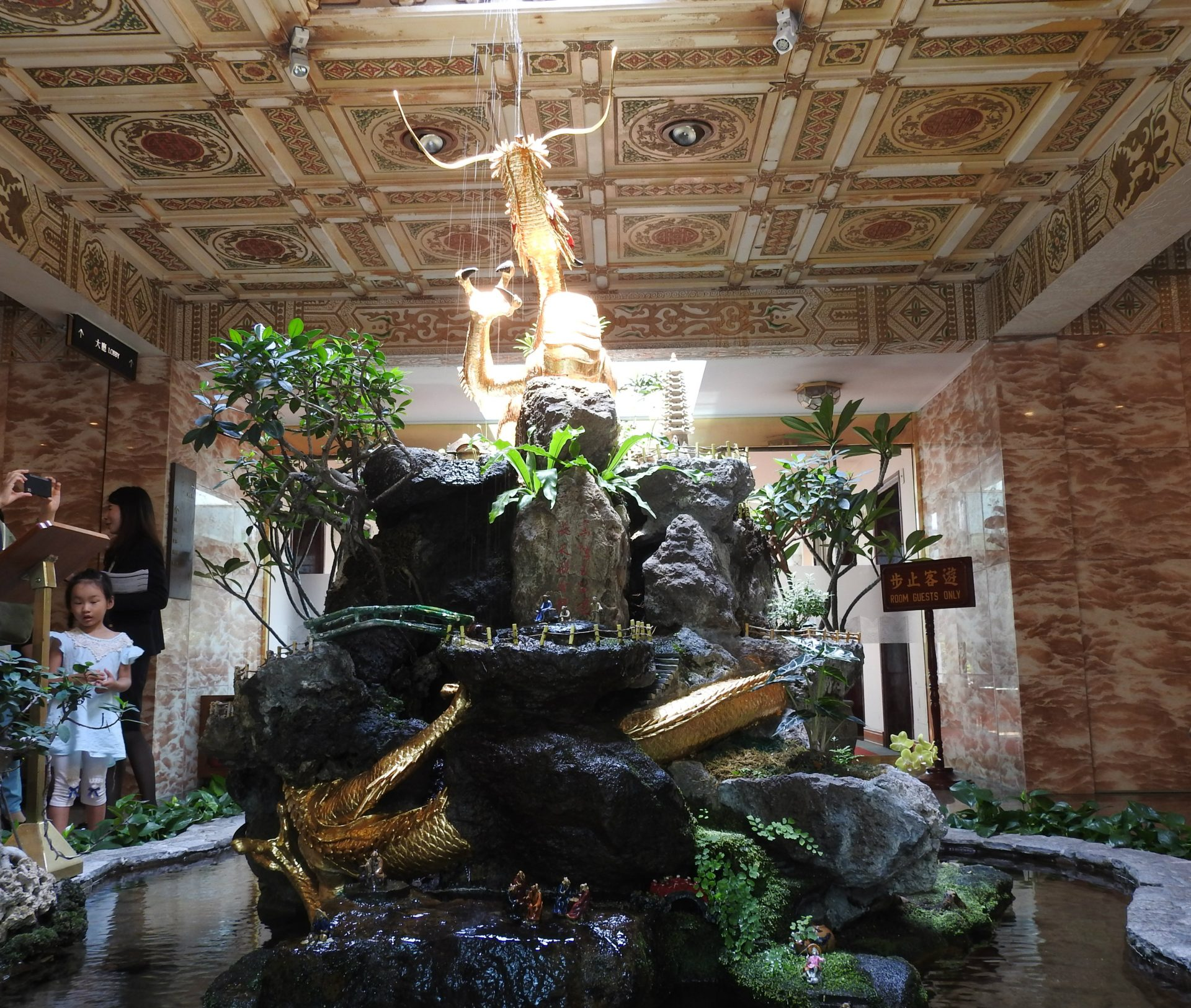 One of the highlights of the Grand Hotel is its century-old Golden Dragon made of bronze and gilded with 24K gold. (Image: Billy Shyu/ Vision Times)