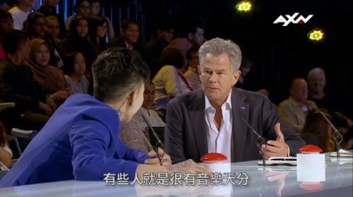 "Judge David Foster, a music celebrity, was so amazed at Feng's performance that he said: ""People think of a ukulele as a toy, and you turned it into an experience!"" (Image: YouTube/Screenshot)"
