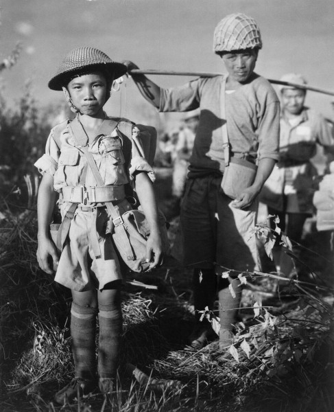 A Chinese Nationalist soldier, age 10, member of a Chinese division from the X Force, boarding planes in Burma bound for China, May 1944. (Image: via wikipedia / CC0 1.0)