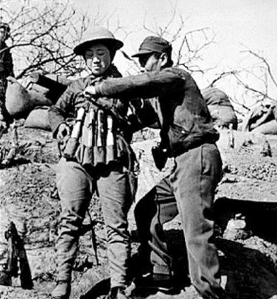 Chinese suicide bomber putting on an explosive vest made out of Model 24 hand grenades to use in an attack on Japanese tanks at the Battle of Taierzhuang. (Image: via wikipedia / CC0 1.0)