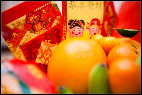 Giving red envelopes with money is a Chinese New Year tradition (Photo Credit: kennymatic Flickr via Compfight cc)