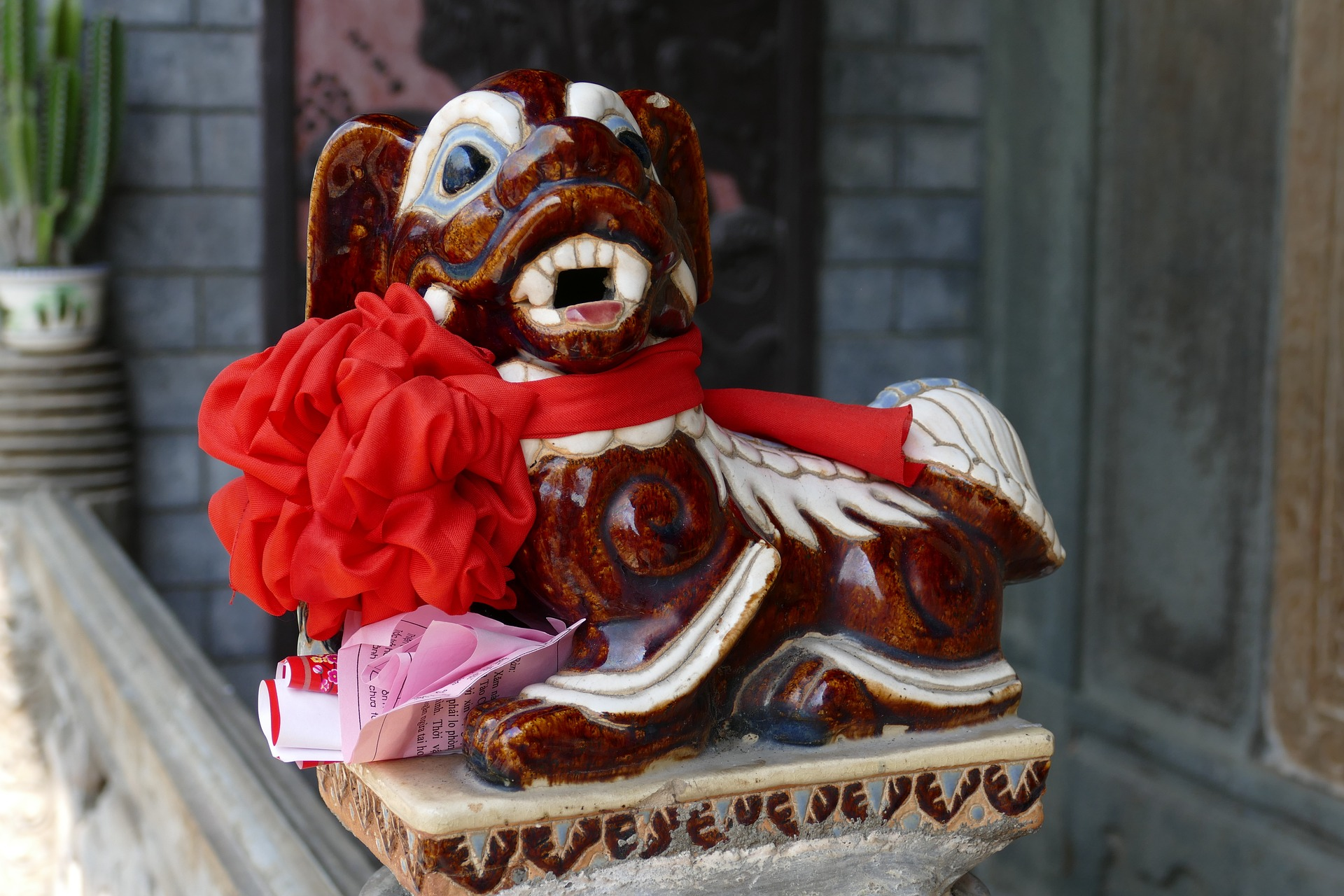 A dog statue. Looking like a mythic dog being of the Chinese Zodiac.