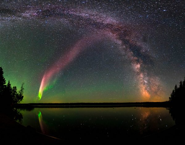 STEVE and the Milky Way at Childs Lake, Manitoba, Canada. The picture is a composite of 11 images stitched together. (Credit: Courtesy of Krista Trinder)
