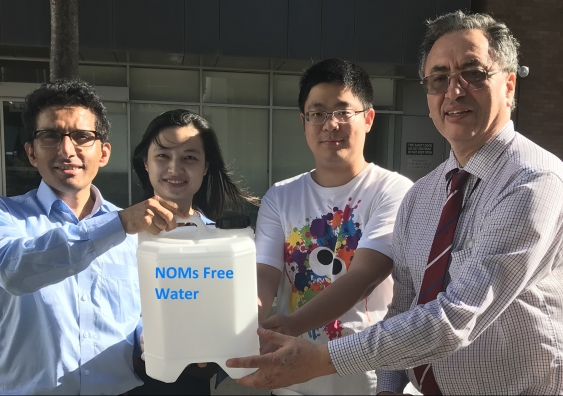 UNSW's Dr Rakesh Joshi (far left) and team members hand over water free of natural organic matter to Sydney Water's Dr Heriberto Bustamante (far right). (Provided by: University of New South Wales)