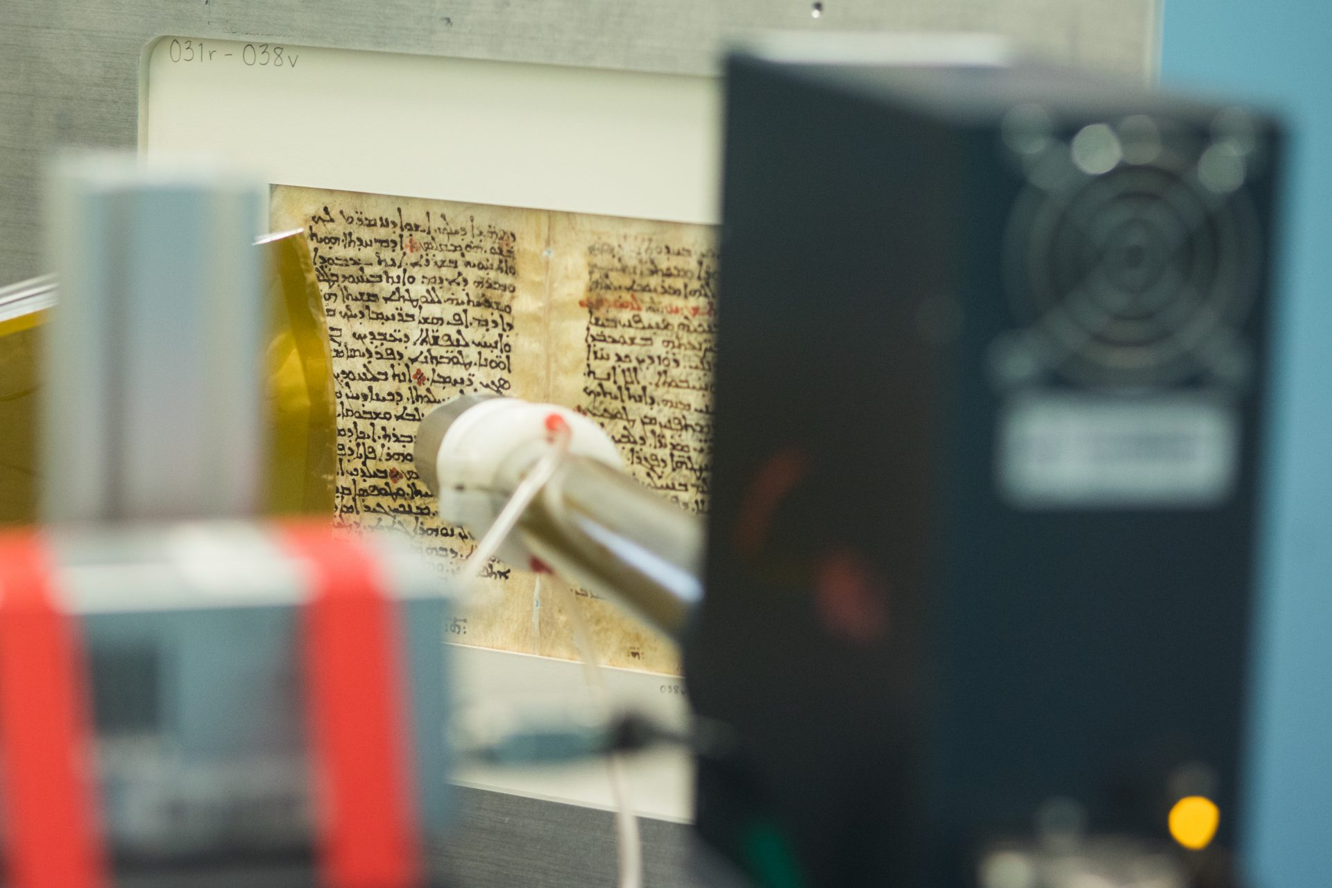 They illuminated the pages with visible, ultraviolet and infrared light to enhance different colors within the inks. While they could identify and read the underlying text on many pages, they still could not read it on others. Credit: Stanford University