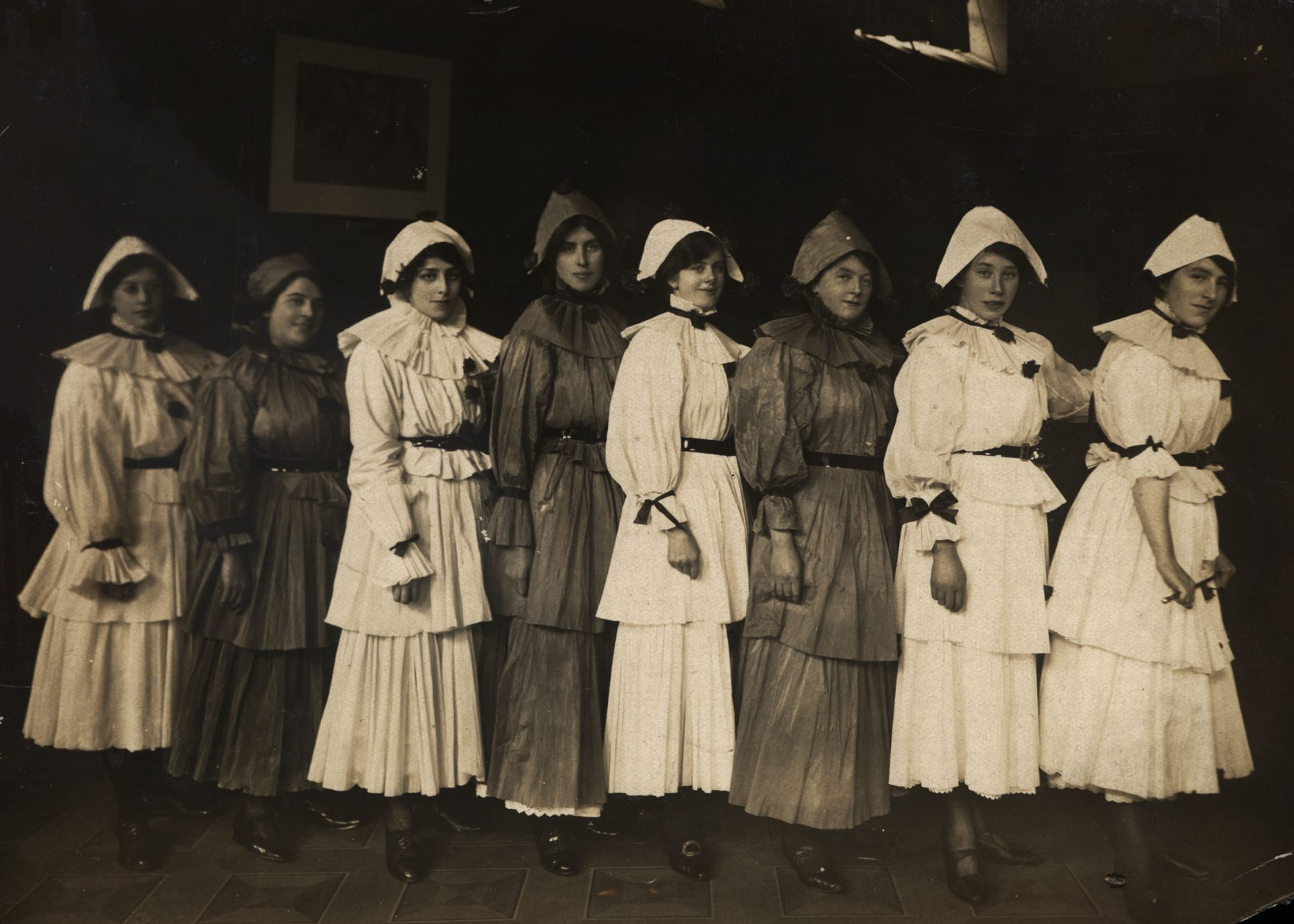 War Time Nurses entertain Wounded Soldiers This is a photograph of sisters and nurses dressed in costume for a Christmas performance at 3rd Northern General Hospital, Sheffield. The photograph was taken in December 1916 and offers a caring and humorous impression of the women working in the Hospital. Reference: DF.BGS-4-7-1 The photograph is part of a larger collection that shows a rare and intimate glimpse in to the Life of a Wounded Soldier recovering from the horrors of World War One. This particular set of photographs is taken from a collection held at Tyne & Wear Archives Information and photo from https://www.flickr.com/photos/twm_news/9490957061/in/photolist-fsFCSH-hz3gCY-4jzbzQ-q66ZrE-HWVZ6f-ptDpcA-bV8e4k-9WYHBp-69xVJT-ovx8G4-4jz73Q-22QBPsW-a5ZMA1-5qCF2q-CcM7V9-awxRsS-GoGWaQ-igKH3n-q1mdPm-4jv8L4-4jz9DE-ft4pso-4jyC7r-4jza33-CBAQRh-hwRfMy-p7dJhK-4G3xux-5BUsv9-4QjZUo-hxANRh-hwSDdH-a5JVno-23rDLyQ-GoGQrA-4jzbLL-9rVbQn-6ivpkL-4Qt4iD-qq17hN-bWHb7P-VGu6HZ-iRwZ9V-Fn6cXS-FgcRiP-htWNUY-qjCKby-C6ppBV-4orZRC-au3QkK