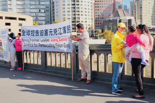 Photo by Tina Wang. On Princes Bridge in Melbourne with the Wall of Courage.